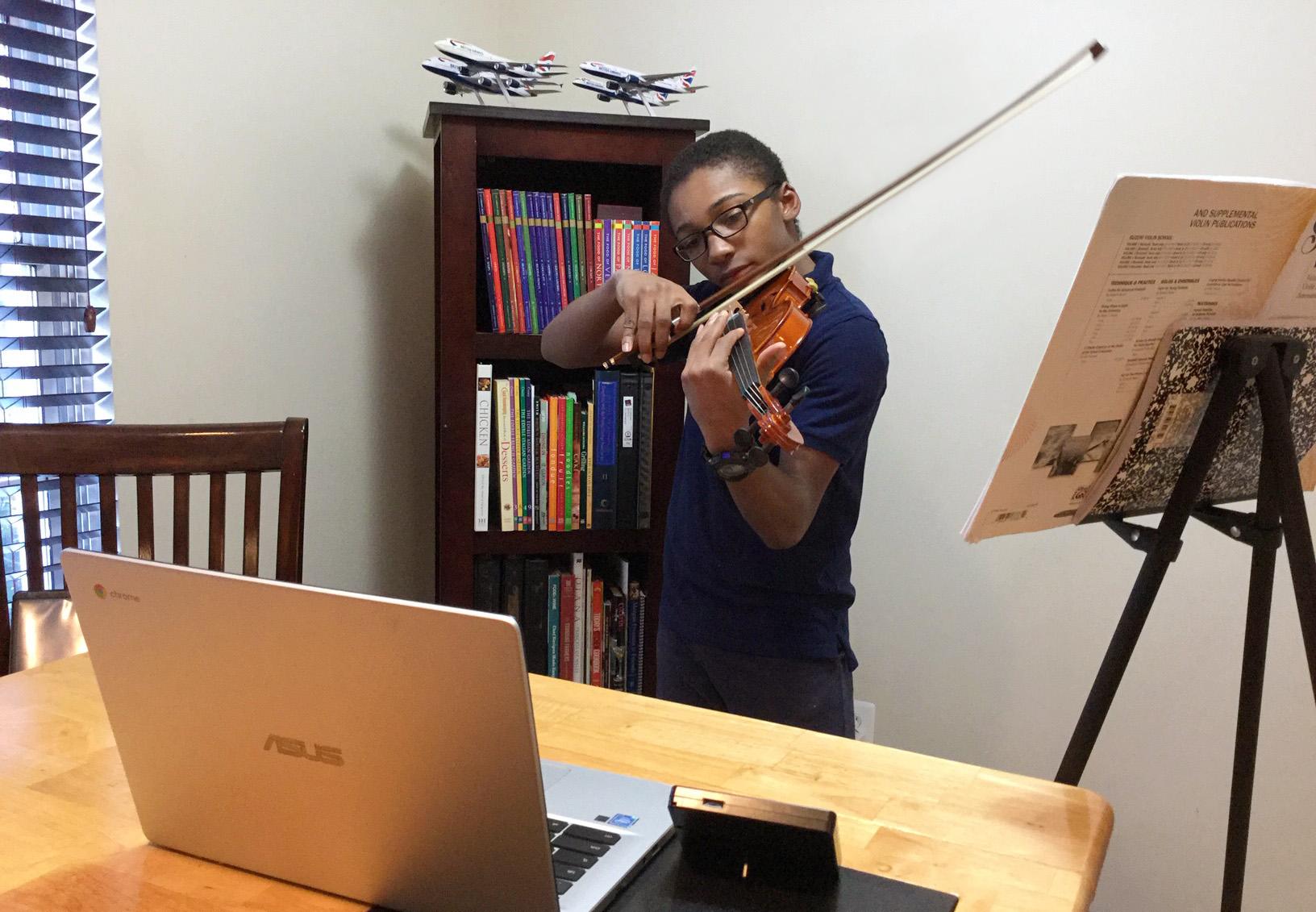 Student taking a remote violin lesson