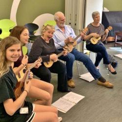 Students having fun in ukulele class